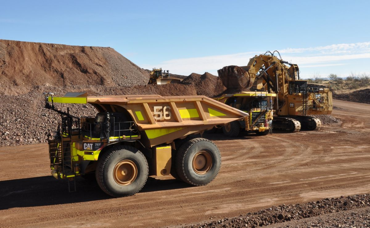 Cat autonomous truck stages for loading as shovel completes loading another 793F CMD in demonstratioon