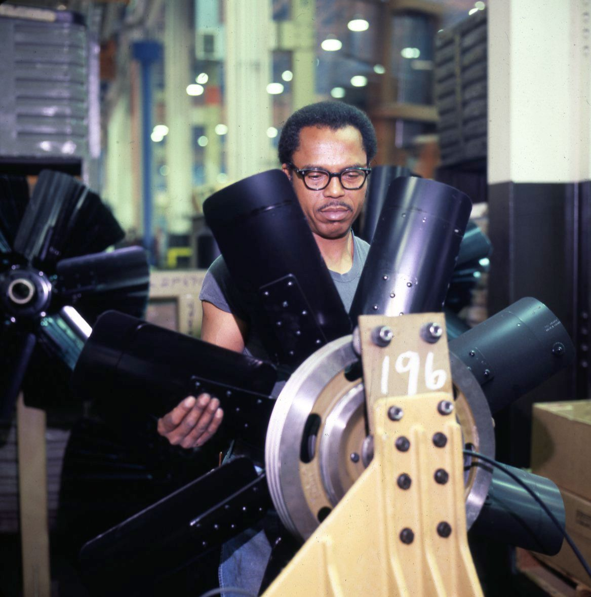 Caterpillar employee working in Mossville plant, ca. 1980.