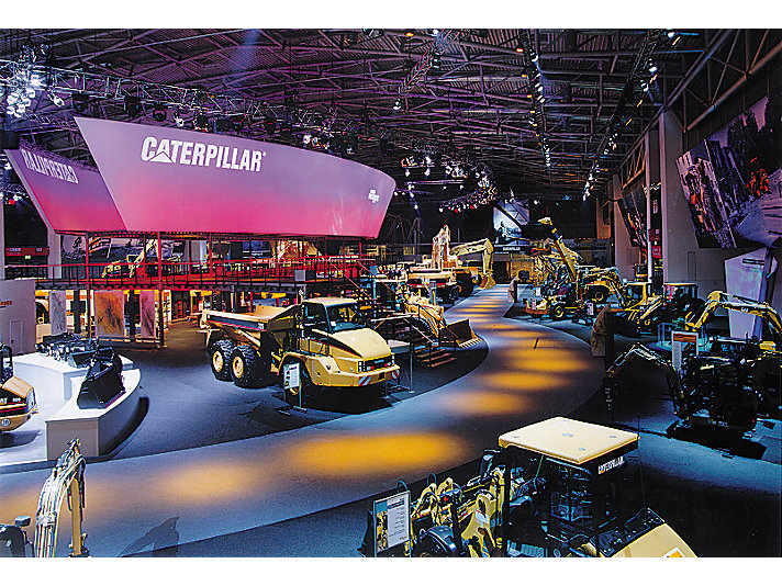 The Caterpillar display at the 2001 show included neon colors and a spotlight lit walkway.