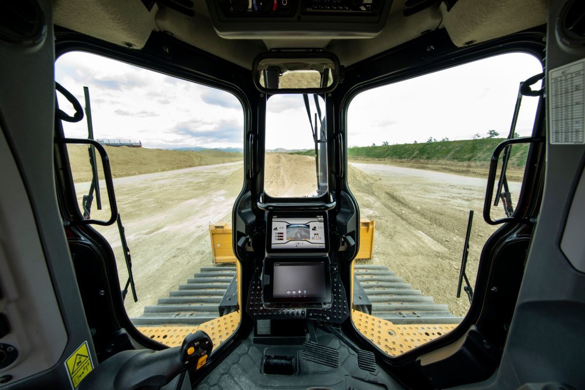 The completely redesigned cab raises the standard in comfort and productivity. Operators will find more space, multiple seat and control adjustments for optimal comfort and a new, easy-to-use 10-inch (254-mm) touchscreen operator interface and standard High Definition rearview camera. About 15% more cab glass area and a steeper hood angle provide enhanced all-around visibility.