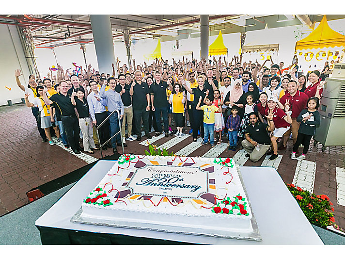 Caterpillar Singapore team celebrates the 50th anniversary.