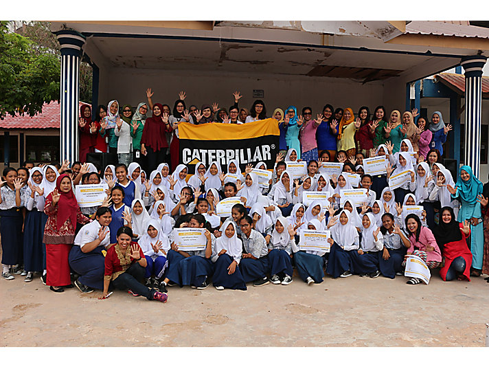 The Caterpillar team visiting a local high school on International Women's Day to inspire and educate students about manufacturing.