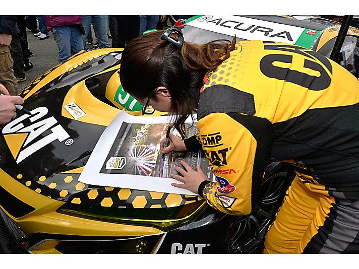 Katherine Legge signing autographs
