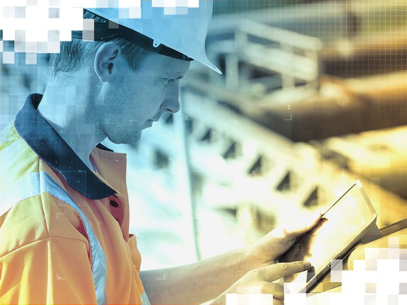 Customer on worksite checking VisionLink