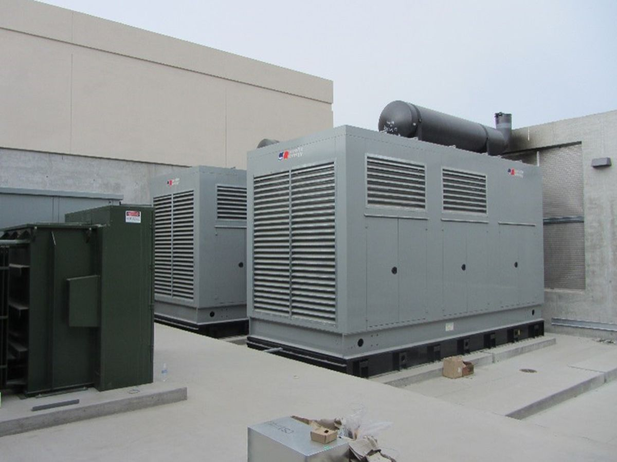 Figure 3: Graton's outdoor paralleling diesel generators are housed in weatherproof enclosures. The installation includes subbase tanks, step-up transformers, mufflers, and fuel containment.