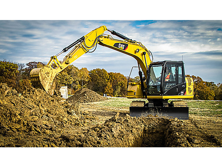 311F RR digging in trenching application with a General Duty Bucket