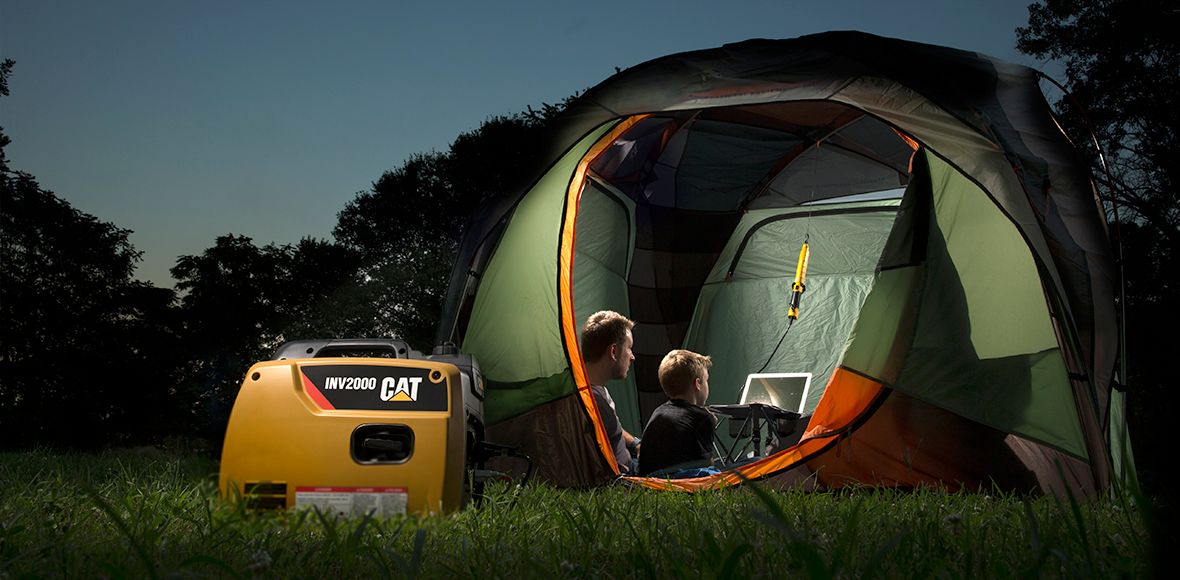 Father and son camping with a Cat INV2000 portable inverter generator