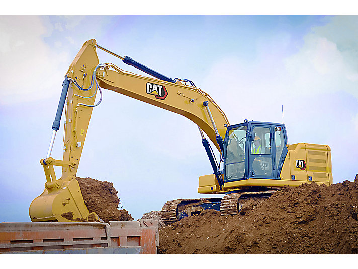 320 Medium Excavator using a General Duty Bucket to load a truck