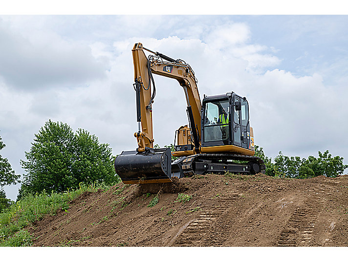 Marine veteran and Cat customer Andrew Purcell runs a 307E from the Cat Rental Store that features smooth, responsive hydraulics that gives operators a level of control demanded for a range of applications, from fine grading and dozing to backfilling.