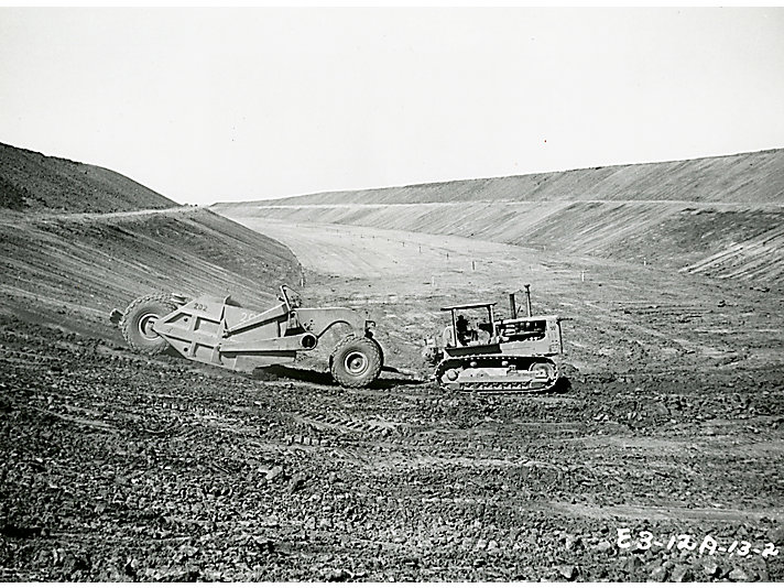 Starting in 1964, Cat machines help construct the Kainji Dam in Nigeria.