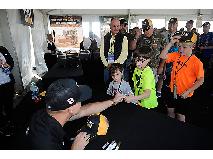 No. 8 driver Daniel Hemric signs autographs for fans in the Cat hospitality tent.