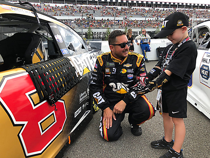 6-year-old Kirk Simon from Long Island serves as honorary pit crew member during the Pocono NASCAR race.