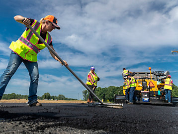 ALL-FEMALE PAVING CREW CRUSHES STEREOTYPES