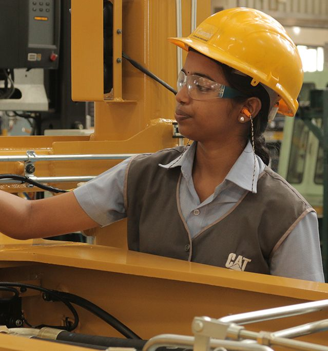woman working on machine