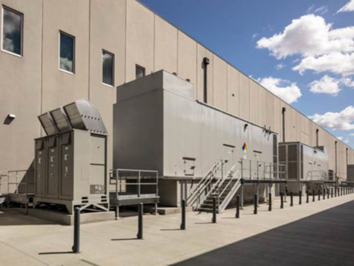Figure 3: N+2 isolated redundant generators in an exterior walk-in enclosure provide back-up power for a co-location data center.