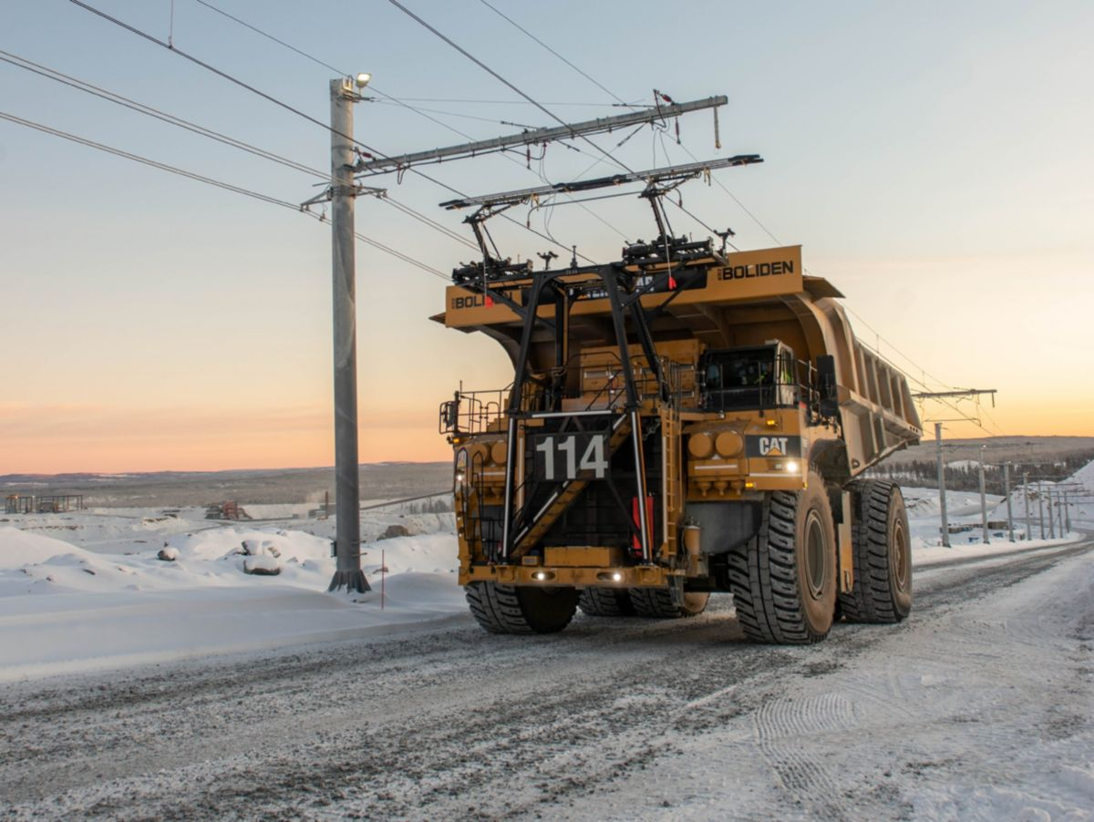 Cat 795 AC mining truck on trolley at Boliden Aitik mine