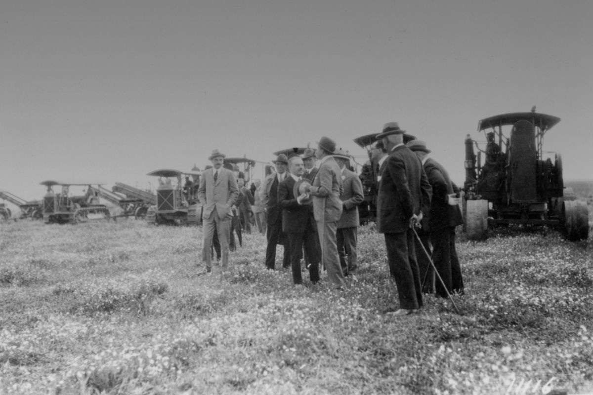 1928 - King of Spain inspecting Caterpillar Sixty Track-Type Tractors and graders at the Islas del Guadalquivar. The King is in the center wearing the bowler hat.