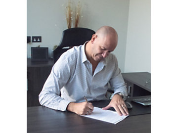 Picture: Claudio Sapio, director of Diesel Motors Co. SRL, signs the distributor agreement.