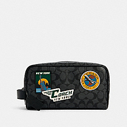 LARGE TRAVEL KIT IN SIGNATURE CANVAS WITH TRAVEL PATCHES - QB/CHARCOAL MULTI - COACH 1276