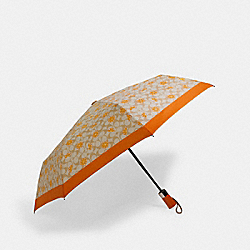 UMBRELLA IN ORANGE SIGNATURE PRINT - SV/LIGHT KHAKI - COACH 1562