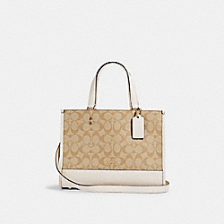 DEMPSEY CARRYALL IN SIGNATURE CANVAS - IM/LIGHT KHAKI CHALK - COACH 1955