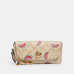 SUNGLASS CASE IN SIGNATURE CANVAS WITH WATERMELON PRINT - LIGHT KHAKI/RED - COACH 2039