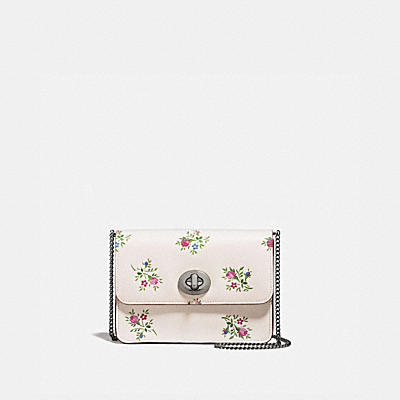 BOWERY CROSSBODY WITH CROSS STITCH FLORAL PRINT AND GLITTER