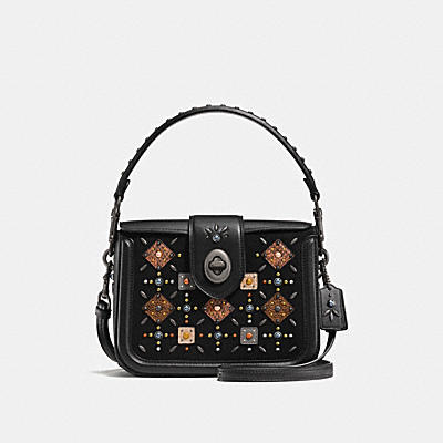 PAGE CROSSBODY WITH PRAIRIE RIVETS AND SNAKESKIN DETAIL