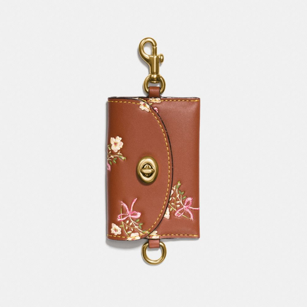 TURNLOCK CARD POUCH WITH FLORAL BOW PRINT