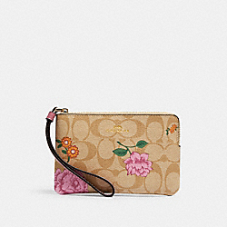CORNER ZIP WRISTLET IN SIGNATURE CANVAS WITH PRAIRIE ROSE PRINT - IM/KHAKI MULTI - COACH 2973