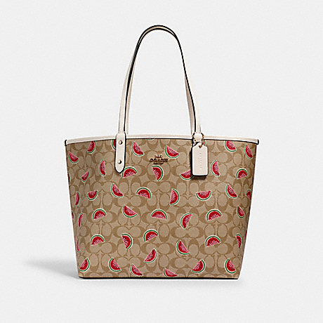 COACH REVERSIBLE CITY TOTE IN SIGNATURE CANVAS WITH WATERMELON PRINT - IM/LT KHAKI/RED MULTI/CHALK - 3039