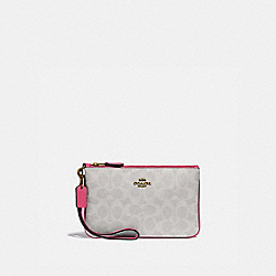 SMALL WRISTLET IN BLOCKED SIGNATURE CANVAS - B4/CHALK CONFETTI PINK - COACH 3050