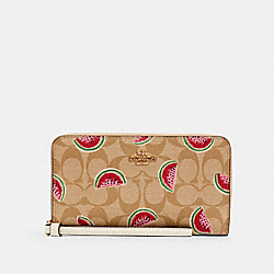 LARGE PHONE WALLET IN SIGNATURE CANVAS WITH WATERMELON PRINT - IM/LT KHAKI/RED MULTI - COACH 3140