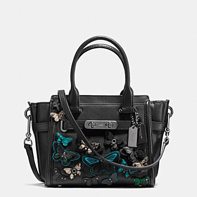 BUTTERFLY APPLIQUE COACH SWAGGER IN GLOVETANNED LEATHER
