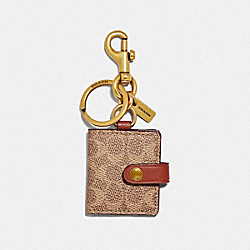 PICTURE FRAME BAG CHARM IN SIGNATURE CANVAS - KHAKI/BRASS - COACH 55785
