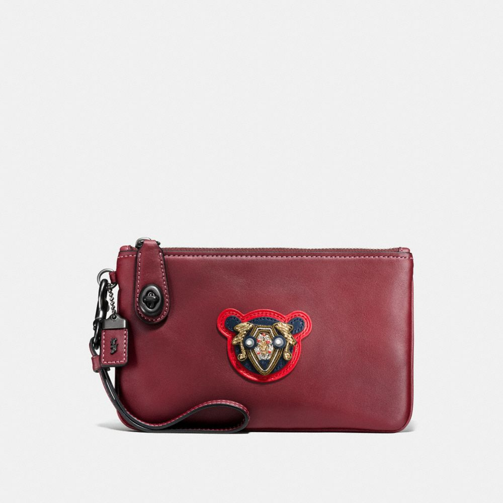 Turnlock Wristlet 21 in Varsity Patches Leather