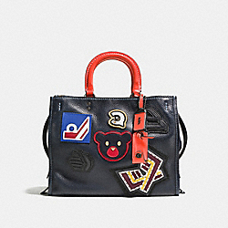 VARSITY PATCH ROGUE BAG IN PEBBLE LEATHER - BP/NAVY - COACH 57231
