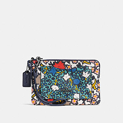 SMALL WRISTLET IN MIXED YANKEE FLORAL PRINT COATED CANVAS