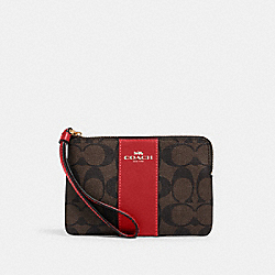 CORNER ZIP WRISTLET IN SIGNATURE CANVAS - IM/BROWN 1941 RED - COACH 58035