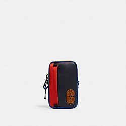 NORTH/SOUTH HYBRID POUCH WITH COACH PATCH - QB/BLUE MULTI - COACH 5803