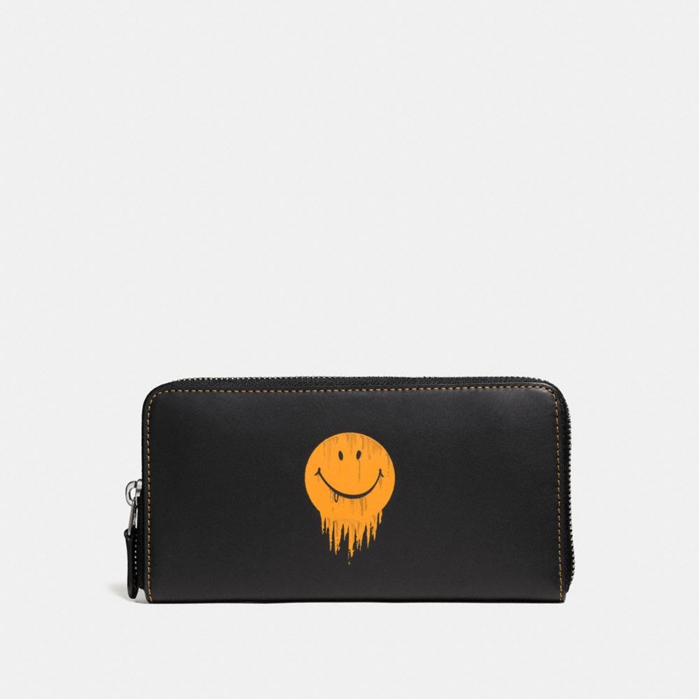 ACCORDION WALLET IN GLOVETANNED LEATHER WITH GNARLY FACE PRINT