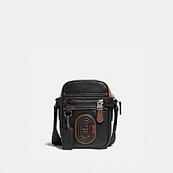 DYLAN 10 WITH SIGNATURE CANVAS BLOCKING AND COACH PATCH - BLACK/KHAKI/BLACK COPPER - COACH 76167
