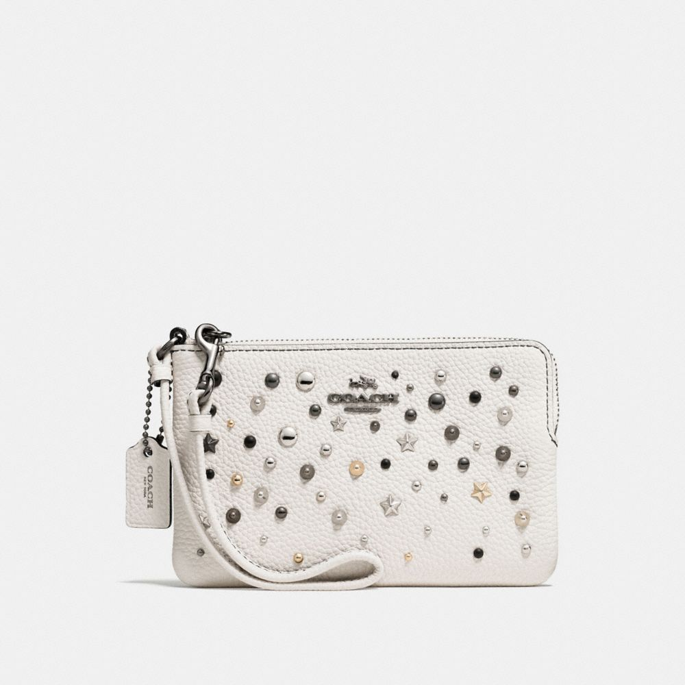 SMALL WRISTLET IN POLISHED PEBBLE LEATHER WITH STAR RIVETS