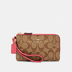 DOUBLE CORNER ZIP WRISTLET IN SIGNATURE CANVAS - IM/KHAKI/FUCHSIA - COACH 87591