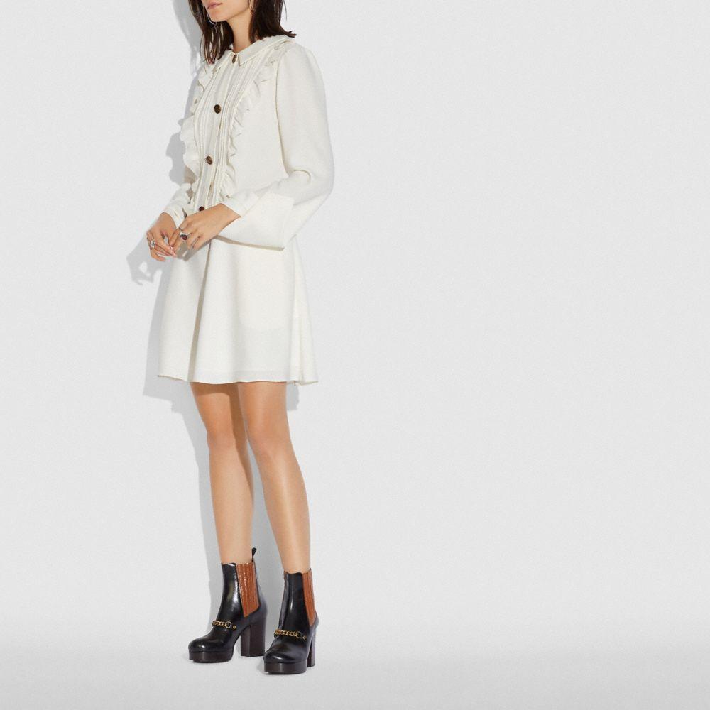 러플 빕 드레스
