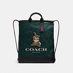DISNEY X COACH TERRAIN DRAWSTRING BACKPACK WITH WAVY ANIMAL PRINT AND THUMPER - QB/DARK GREEN MULTI - COACH 89900