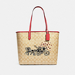 REVERSIBLE CITY TOTE IN SIGNATURE CANVAS WITH HORSE AND CARRIAGE HEARTS MOTIF - SV/LIGHT KHAKI MULTI/POPPY - COACH 91011