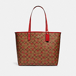 REVERSIBLE CITY TOTE IN SIGNATURE CANVAS WITH CRAYON HEARTS PRINT - IM/KHAKI MULTI TRUE RED - COACH 91014