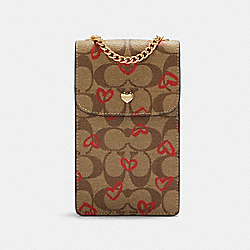 NORTH/SOUTH CROSSBODY IN SIGNATURE CANVAS WITH CRAYON HEARTS PRINT - IM/KHAKI RED MULTI - COACH 91046