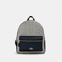 MEDIUM CHARLIE BACKPACK IN BLOCKED SIGNATURE CANVAS - SV/CHALK MULTI - COACH 91074